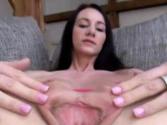 Orgasm starved brunette gaps her pink soft pussy in close-up